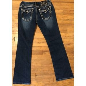 Miss me signature boot jeans flap pockets